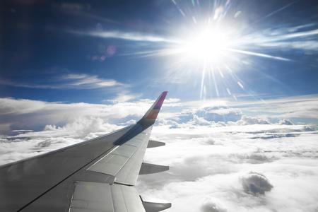 Wing of the plane on blue sky background Standard-Bild - 126612726