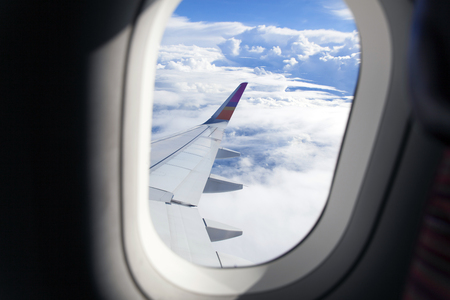 Airplane wing out of window and beautiful cloud Standard-Bild - 126612727