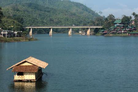 houseboat on the lake with bridge photo