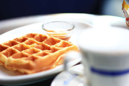 Waffles with hot coffee photo