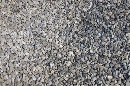 road surface: Gravel road surface texture background in daytime