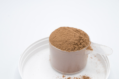 savour: Chocolate whey protein powder 1 scoop isolated white background Stock Photo