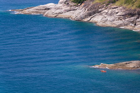 Tourists paddling kayak on the sea in daytime at Phuket province, Thailand Фото со стока