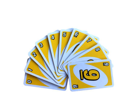 CHIANGMAI, THAILAND - NOVEMBER 7, 2018: Yellow number card game arrange from one to nine isolated on white background