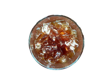 Ice black coffee in transparent glass isolated on white background. Top view image with light reflection. Imagens