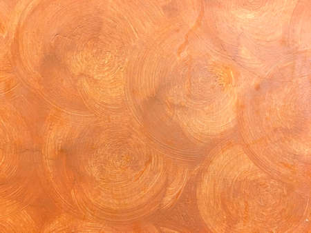 Abstract orange brick color circle plaster on the cement wall. Beautiful art interior building. Imagens