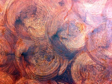 Abstract dark scarlet color circle plaster on the cement wall like wooden trunk. Beautiful art interior building.