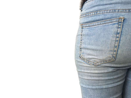 Young woman bottom in tight light blue jeans isolated on white background. Imagens