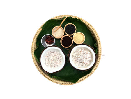 Nature ingredient powder and old coconut meat slide for skin and face scrub and massage in the spa of Thailand isolated on white background.