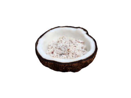 Halve old coconut with meat slice inside isolated on white background.