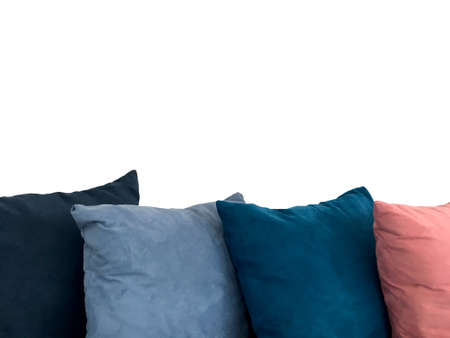 Colorful decorative resting pillow stack on sofa isolated on white background. Imagens
