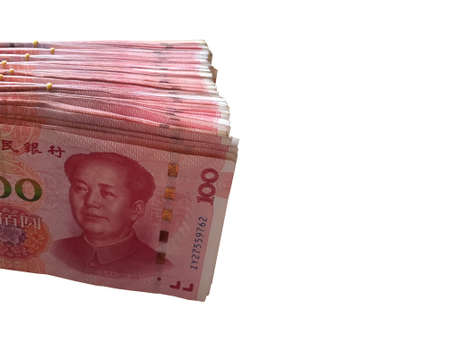 One hundred Chinese yuan money stacking isolated on white background. Chinese banknotes.