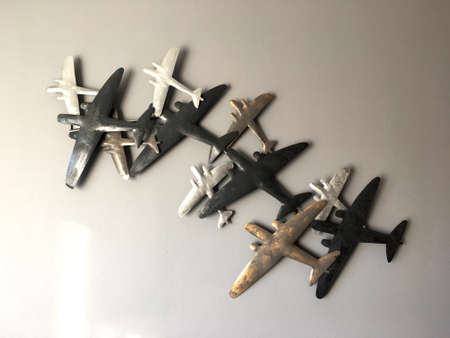 Steel airplane model overlap and fix on the wall. Room decorative interior concept idea.