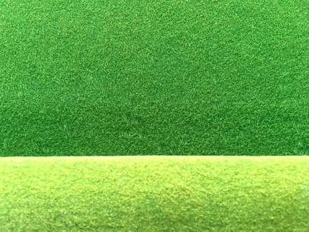 Green felt fabric texture with light green edge background. Pool and snooker table surface.