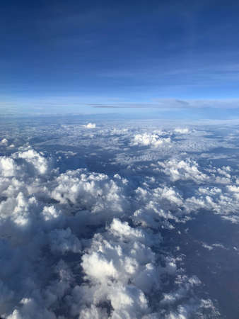 Beautiful blue sky and white cloud horizontal line from airplane view. Color shade of nature background.