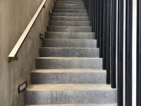 Concrete staircase with stainless steel holder from bottom view. Imagens