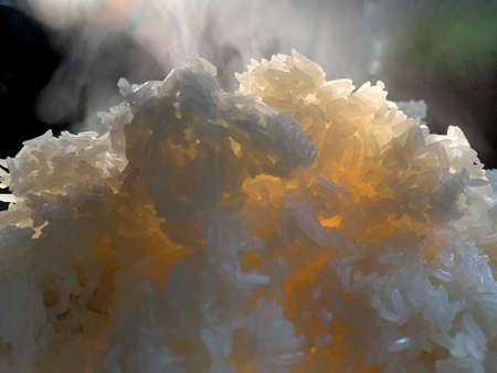 Close up hot sticky rice with smoke after boil.
