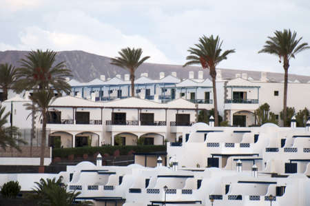 white house with palm trees on the island of Lanzarote Stock Photo - 16652824