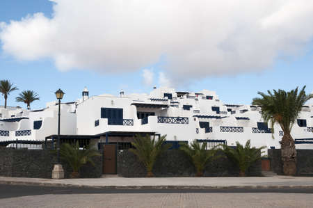 Lanzarote houses white color with decorative trees Stock Photo - 16652846
