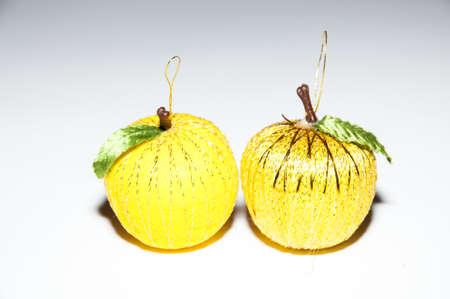 simulating: Christmas balls simulating a yellow colored fruit