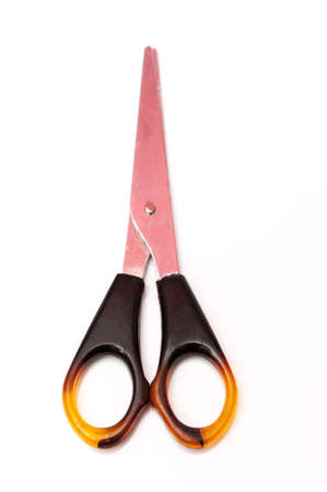 small scissors cutting brown color on a white background Stock Photo - 17226657
