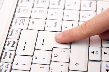 typing on the laptop with finger enter key Stock Photo - 17310719
