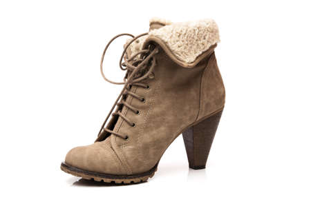 low beige boots on white background photo