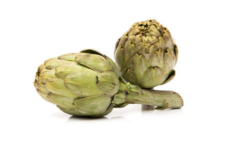 Fresh artichokes on a white background photo