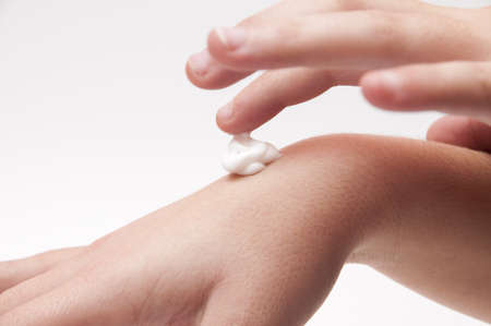 Taking Care hands with cream on a white background