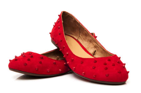 Spiked red shoes on a white background