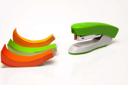 stapler with colored paper on a white background photo