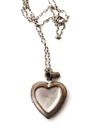 necklace with a heart-shaped piece on a white background