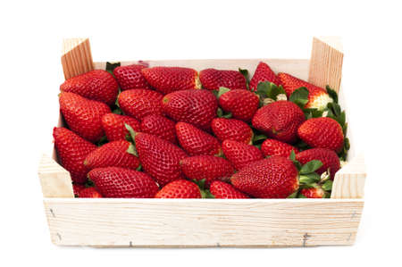 box of strawberries on a white background photo