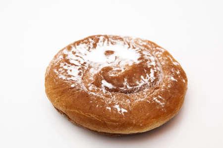 ensaimada with sugar on a white background Stock Photo