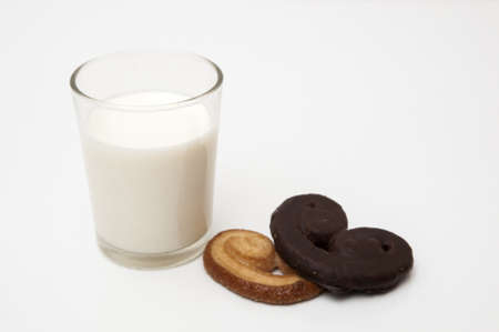 glass of milk with heart shaped cookies on a white background photo