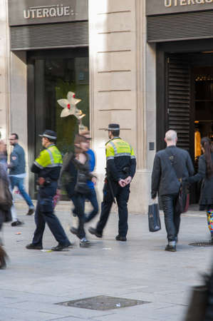arma: Police patrolling the streets in Barcelona the day 29-03-2013