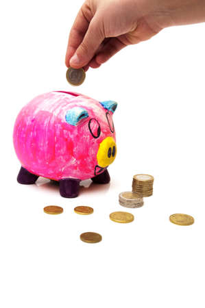 piggy bank with money on a white background photo