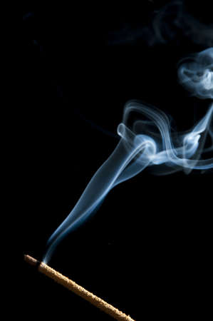 candle smoke odor on a black background Stock Photo