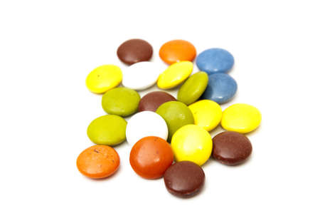 colorful candies on a white background photo