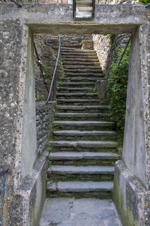stone staircase with narrow walls Stock Photo