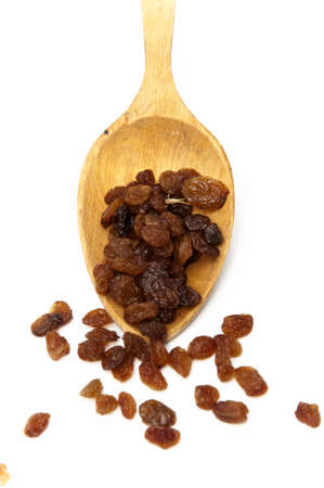 raisins with a spoon on a white background photo