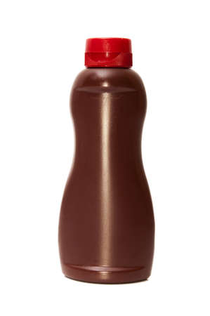 chocolate syrup bottle on a white background