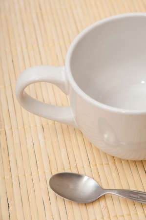 Coffee cup and spoon on a wood background Stock Photo - 22761228
