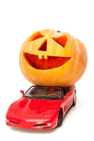 halloween pumpkin with a sports car