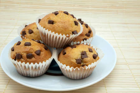 madalena: chocolate muffins on a wooden background