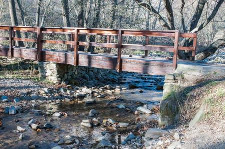 bridged: bridged path through which the river Stock Photo