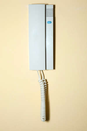 landlines: phone hanging on the wall of a house Stock Photo