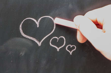 red hearts on a school blackboard photo