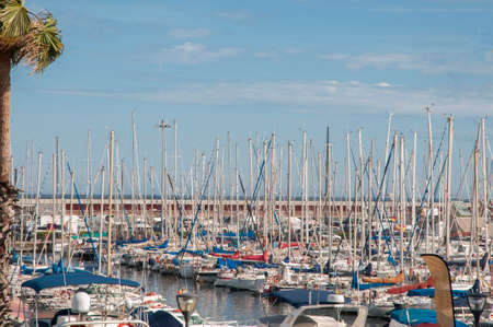 Barcelona harbor where boats are seen