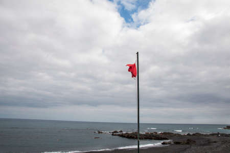 red canary: red flag on the beaches of the Canary Islands